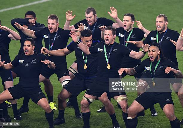 New Zealand's flanker and captain Richie McCaw leads a celebratory Haka after winning the final match of the 2015 Rugby World Cup between New Zealand...