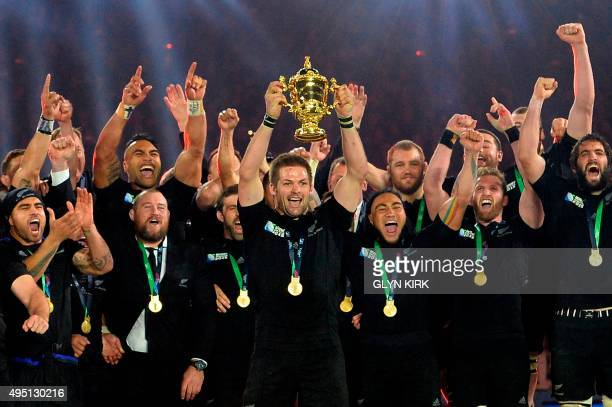 New Zealand's flanker and captain Richie McCaw lifts the Webb Ellis Cup during the final match of the 2015 Rugby World Cup between New Zealand and...