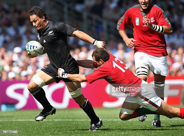 New Zealand's flanker Chris Masoe escapes Portugal's winger Miguel Portela to score during their rugby union World Cup group C match New-Zealand vs....