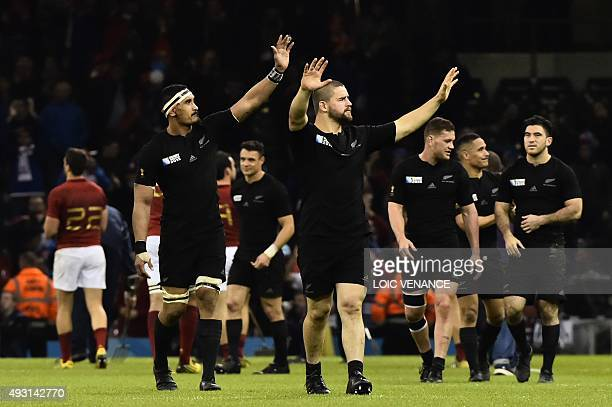 New Zealand's flanker Jerome Kaino and New Zealand's hooker Dane Coles celebrate after winning a quarter final match of the 2015 Rugby World Cup...
