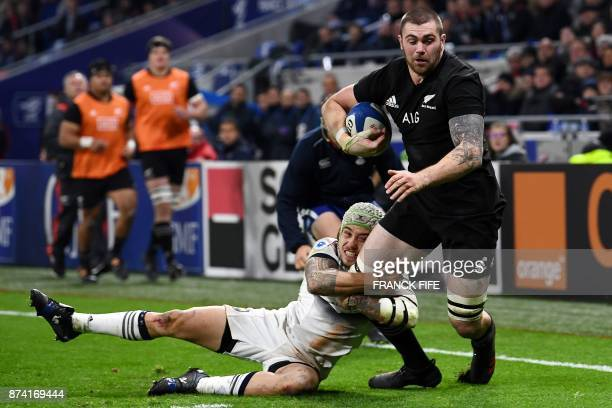 New Zealand's flanker Liam Squire is tackled by France's right wing Gabriel Lacroix during the international rugby union test match between France...