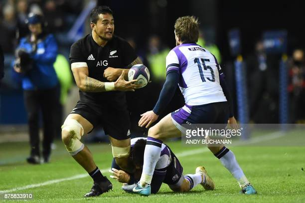 New Zealand's flanker Vaea Fifita holds the ball against Scotland's fullback Stuart Hogg during the international rugby union test match between...