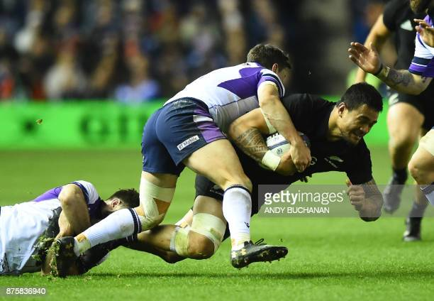 New Zealand's flanker Vaea Fifita is brought down during the international rugby union test match between Scotland and New Zealand at Murrayfield...