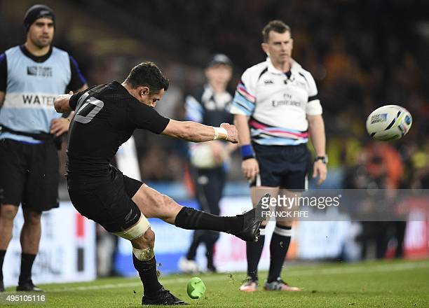 New Zealand's fly half Dan Carter converts the first try during the final match of the 2015 Rugby World Cup between New Zealand and Australia at...