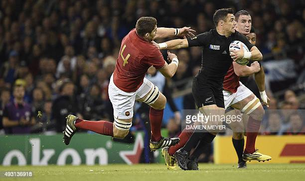 New Zealand's fly half Dan Carter evades France's lock Pascal Pape during a quarter final match of the 2015 Rugby World Cup between New Zealand and...
