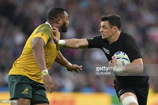 New Zealand's fly half Dan Carter is challenged by Australia's prop Sekope Kepu during the final match of the 2015 Rugby World Cup between New...