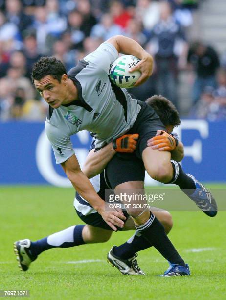 CORRECTION New Zealand's flyhalf Daniel Carter is tackled by Scotland's fullback Hugo Southwell during the rugby union World cup match Scotland vs...