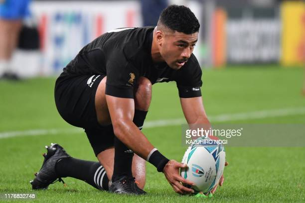 New Zealand's flyhalf Richie Mo'unga prepares to kick the ball during the Japan 2019 Rugby World Cup quarterfinal match between New Zealand and...