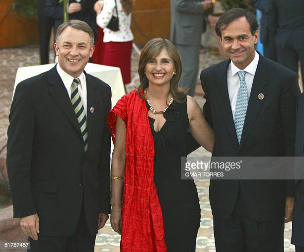 New Zealand's Foreign Affairs and Trade Minister Philip Goff , Chilean Foreign Affairs Minister Ignacio Walker and his wife pose before a dinner in...