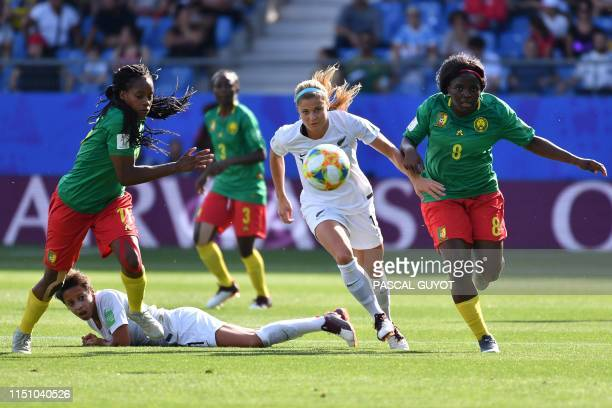 TOPSHOT New Zealand's forward Rosie White vies for the ball with Cameroon's defender Aurelle Awona and Cameroon's midfielder Raissa Feudjio during...