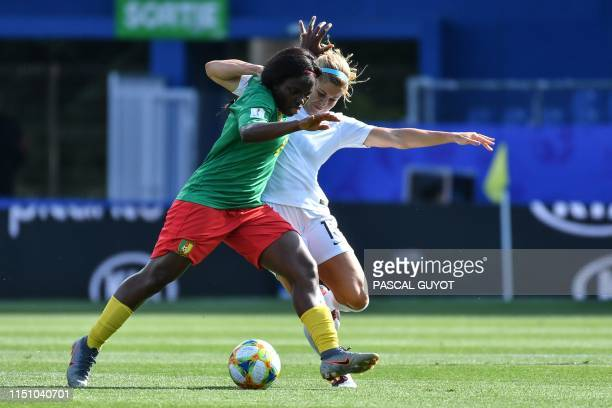 New Zealand's forward Rosie White vies for the ball with Cameroon's midfielder Raissa Feudjio during the France 2019 Women's World Cup Group E...