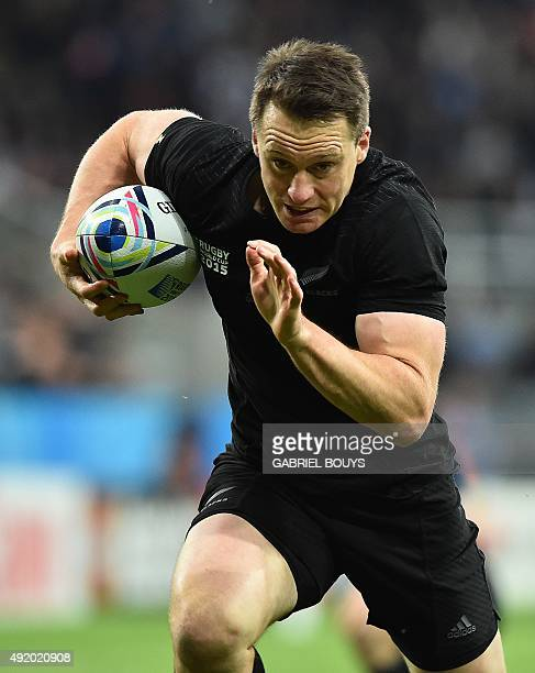 New Zealand's fullback Ben Smith runs to score the first try during a Pool C match of the 2015 Rugby World Cup between New Zealand and Tonga at St...
