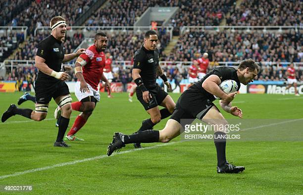 New Zealand's fullback Ben Smith scores the first try during a Pool C match of the 2015 Rugby World Cup between New Zealand and Tonga at St James'...