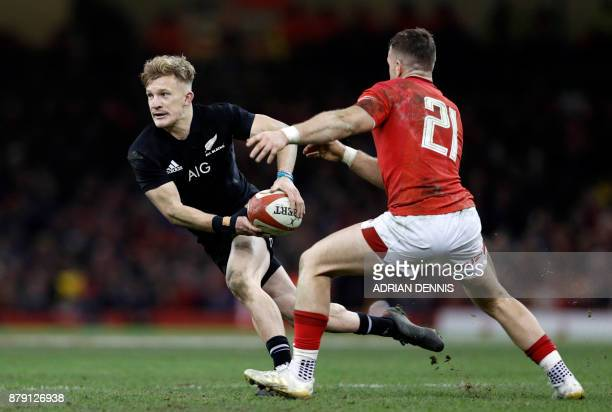 New Zealand's full-back Damian McKenzie is tackled by Wales' scrum-half Gareth Davies during the Autumn international rugby union Test match between...