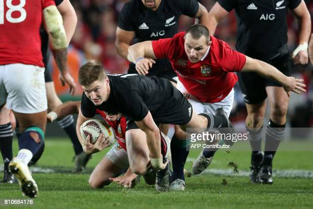 New Zealand's fullback Jordie Barrett is tackled during the third rugby union Test match between the British and Irish Lions and New Zealand All...
