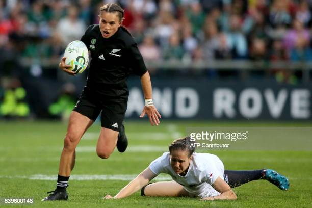 New Zealand's fullback Selica Winiata evades the tackle from England's centre Emily Scarratt during the Women's Rugby World Cup 2017 final match...