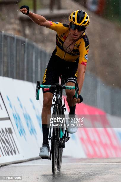 New Zealand's George Bennett of Jumbo Visma celebrates as he crosses the finish line to win the 104th edition of the one-day classic cycling race...