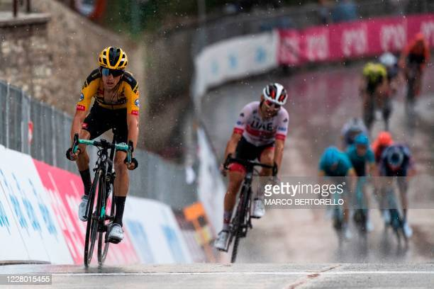 New Zealand's George Bennett of Jumbo Visma crosses the finish line of the 104th edition of the one-day classic cycling race Gran Piemonte on August...