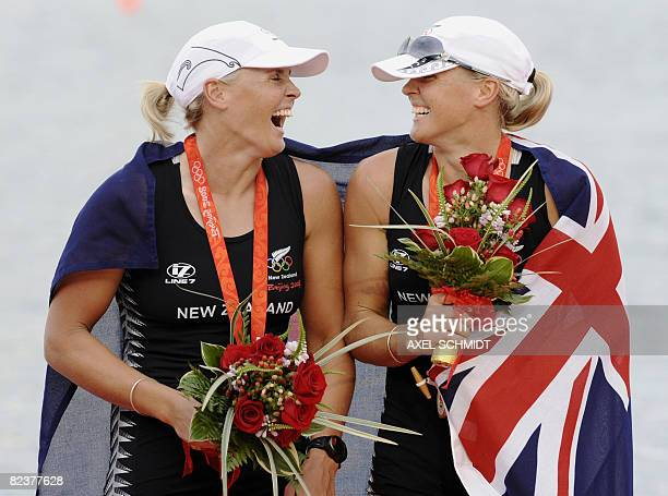 New Zealand's Georgina Evers-Swindell and Carolina Evers-Swindell smile during the medals ceremony for the women's double sculls at the Shunyi Rowing...