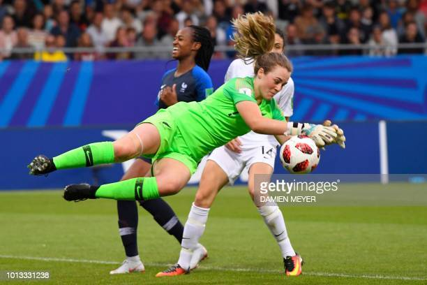 New Zealand's goalkeeper Anna Leat grabs the ball close to France's forward MarieAntoinette Katoto and New Zealand's defender Claudia Bunge during...