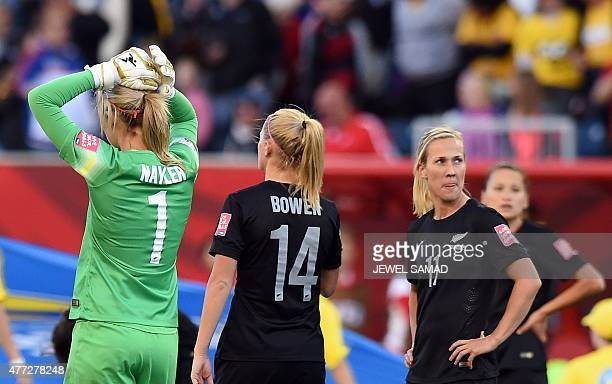 New Zealand's goalkeeper Erin Nayler and her teammates react at the end of their Group A football match of the 2015 FIFA Women's World Cup against...
