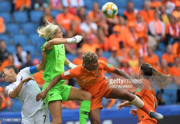 TOPSHOT New Zealand's goalkeeper Erin Nayler boxes the ball in front of Netherlands' forward Shanice van de Sanden during the France 2019 Women's...