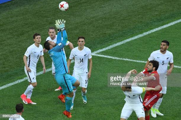 New Zealand's goalkeeper Stefan Marinovic jumps for the ball during the 2017 Confederations Cup group A football match between Russia and New Zealand...