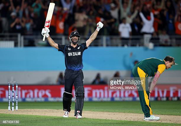New Zealand's Grant Elliott celebrates hitting the winning runs as South Africa's Dale Steyn looks dejected during the semifinal Cricket World Cup...