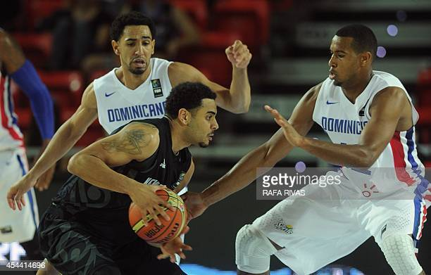 New Zealand's guard Corey Webster vies with Dominican Republic's forward Orlando Sanchez and Dominican Republic's guard Juan Coronado during the 2014...