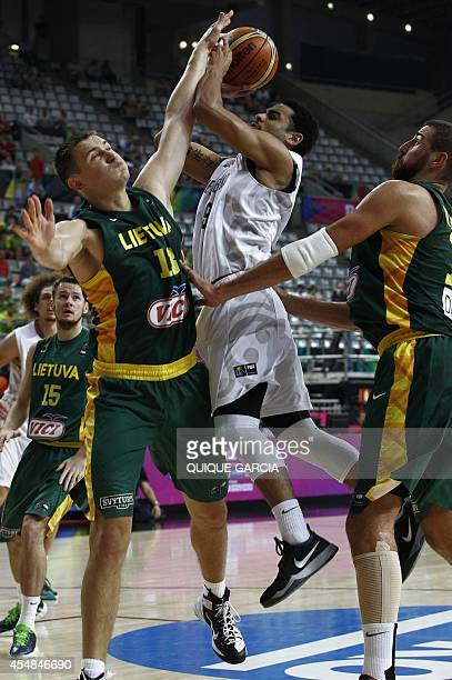New Zealand's guard Corey Webster vies with Lithuania's forward Paulius Jankunas during the 2014 FIBA World basketball championships round of 16...