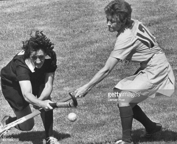 S NOT GET CROSSED UP New Zealand's H E Baird and Australia's Isobel Markwell go after a loose P ball during Saturday's international women's field...
