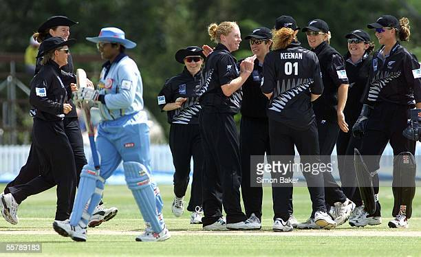 New Zealand's Haidee Tiffencentreis congratulated by team mates after bowling India's Purnima Rau for 14 during their CricInfo Womens World Cup...