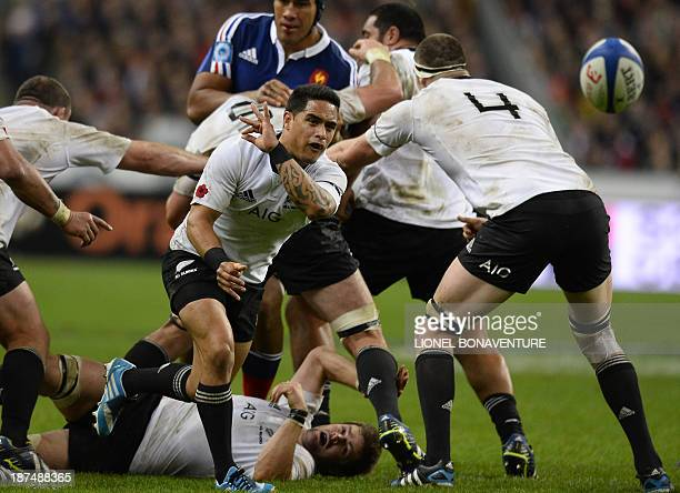 New Zealand's halfback Aaron Smith passes the ball during the rugby union test match between France and New Zealand at the Stade de France in...