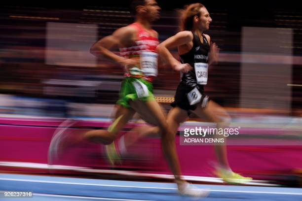 New Zealand's Hamish Carson and Morocco's Younes Essalhi compete in the men's 3000m round 1 heats at the 2018 IAAF World Indoor Athletics...