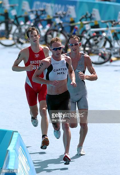 New Zealand's Hamish Carter leads his teammate Bevan Docherty with Sweden's Sven Riederer who finished 3rd in behind in the Mens Triathlon at the...