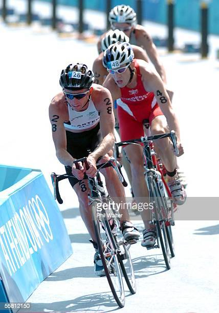 New Zealand's Hamish Carter leads Sweden's Sven Riederer on the cycle leg in the Mens Triathlon at the Olympic Games in Athens Greece Thursday August...