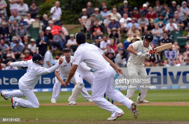 New Zealand's Hamish Rutherford hits a shot past England's Ian Bell during Day Three of the First Test at the University Oval Dunedin New Zealand