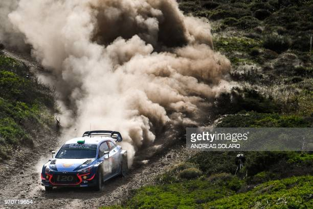 TOPSHOT New Zealand's Hayden Paddon and codriver Britain's Sebastian Marshall steer their Hyundai N i20 Coupe WRC during the 2018 FIA World Rally...