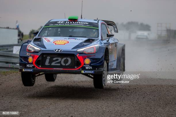 New Zealand's Hayden Paddon and his codriver British Sebastian Marshall steer their Hyundai i20 Coupe WRC during the super special stage of the Orlen...