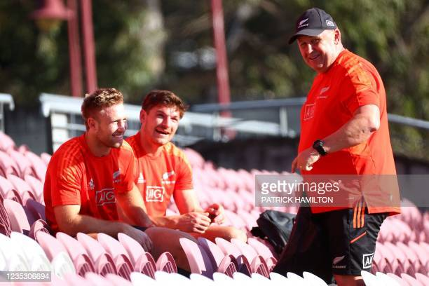 New Zealand's head coach Ian Foster talks to players, Braydon Ennor and George Bridge, during the captain's run in Brisbane on September 17 ahead of...