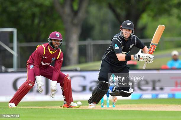 New Zealand's Henry Nicholls bats as West Indies wicketkeeper Shai Hope looks on during the third oneday international cricket match between New...