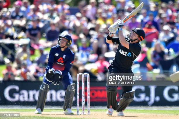 TOPSHOT New Zealand's Henry Nicholls bats watched by England's keeper Jos Buttler during the fifth and final ODI cricket match between New Zealand...