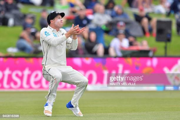 New Zealand's Henry Nicholls catches England's Jonny Bairstow during day four of the second cricket Test match between New Zealand and England at...