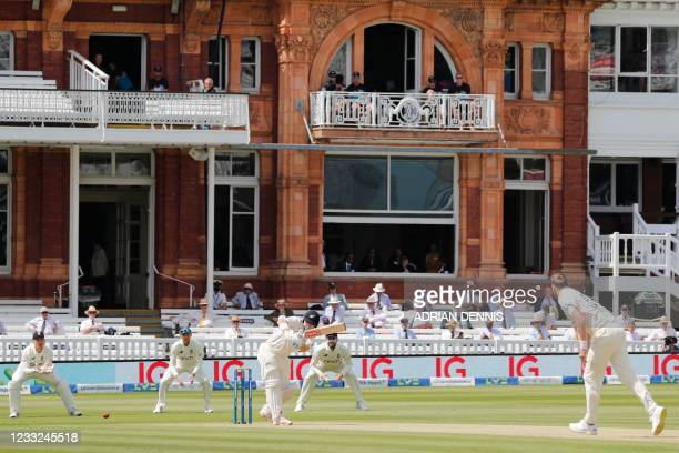 New Zealand's Henry Nicholls plays a shot off the bowling of England's Ollie Robinson during play on the second day of the first Test cricket match...
