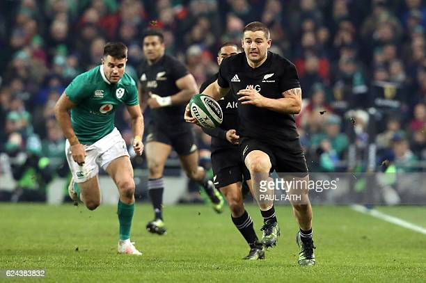 New Zealand's hooker Dane Coles runs with the ball during the rugby union test match between Ireland and New Zealand at the Aviva stadium in Dublin...