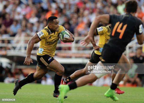 New Zealand's Hurricanes centre Ngani Laumape runs with the ball during their Super Rugby match against Argentina's Jaguares at Jose Amalfitani...