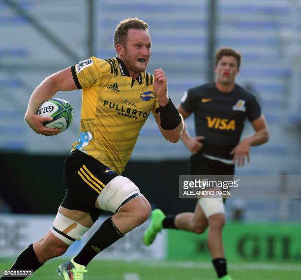 New Zealand's Hurricanes N8 Gareth Evans runs during their Super Rugby match against Argentina's Jaguares at Jose Amalfitani stadium in Buenos Aires...