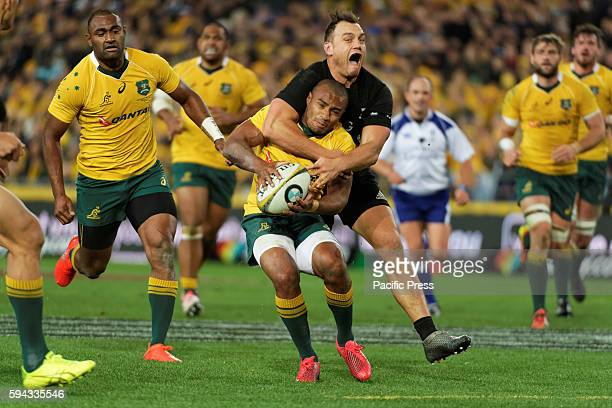 ANZ STADIUM SYDNEY NSW AUSTRALIA New Zealand's Israel Dagg gets a penalty for a high tackle on Australia's Will Genia during the first rugby union...