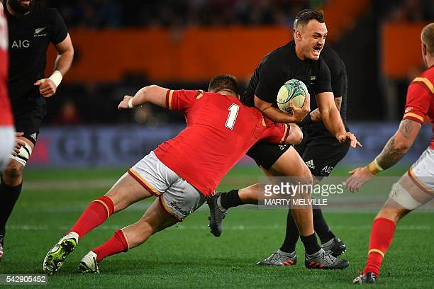 New Zealand's Israel Dagg is tackled by Rob Evans of Wales during the third rugby union Test match between the New Zealand All Blacks and Wales at...