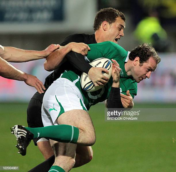 New Zealand's Israel Dagg tackles Geordan Murphy of Ireland during the Rugby Union Test match between the New Zealand All Blacks and Ireland at the...